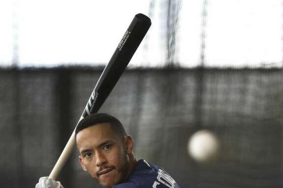 Houston Astros shortstop Carlos Correa (1) takes batting practice in the batting cages during spring training at The Ballpark of the Palm Beaches, in West Palm Beach, Florida, Tuesday, February 21, 2017. ( Karen Warren / Houston Chronicle )