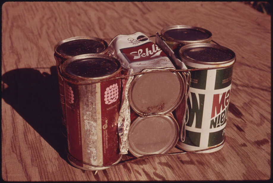 "Original caption: ""Basic building block of experimental housing being built of empty steel beer and soft drink cans near Taos, New Mexico. A total Of eight cans weighing 14 ounces are wired together and placed in mortar in the outside walls at a cost of 15 cents per unit."" David Hiser photo, National Archives. Photo: NARA, Courtesy National Archives"