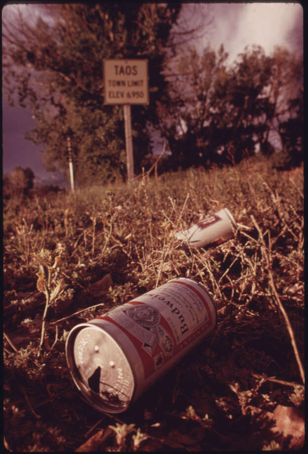 """Original caption: """"Empty steel beer and soft drink cans were accumulated from a variety of sources near Taos, New Mexico, to be used in building experimental houses. Because 70,000 cans are needed to build one structure, the can manufacturing industry is watching with interest."""" Photo by David Hiser, National Archives. Photo: NARA, Courtesy National Archives"""