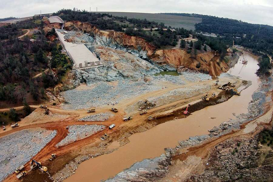 The damaged main spillway of the Oroville Dam is seen at the top left, as officials continue to work on clearing debris from the bottom on Friday, March 3, 2017, in Oroville, Calif. Photo: Santiago Mejia, The Chronicle