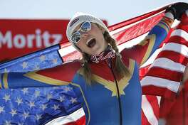 Mikaela Shiffrin, of the U.S.A., celebrates her gold medal in the women's slalom at the alpine skiing World Championships in St. Moritz, Switzerland, Saturday, Feb. 18, 2017. (AP Photo/Marco Trovati)