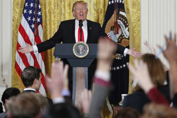 Reporters raise their hands as President Donald Trump fields questions during a news conference in the East Room of the White House in Washington, Thursday, Feb. 16, 2017. (AP Photo/Pablo Martinez Monsivais)