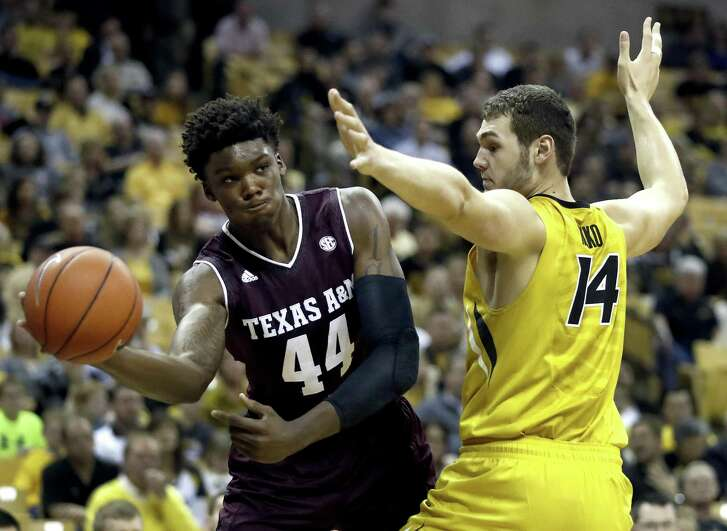 Texas A&M's Robert Williams (44) passes around Missouri's Reed Nikko (14) during the first half on Feb. 28, 2017, in Columbia, Mo.