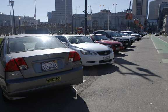 A car is parked straight into a designated spot for back-angle parking only on Polk Street in front of City Hall in San Francisco, Calif. Friday, March 6, 2015.