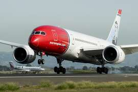 A Norwegian Air plane arriving from Stockholm touches down at Oakland International Airport on Friday, March 3, 2017, in Oakland, Calif.