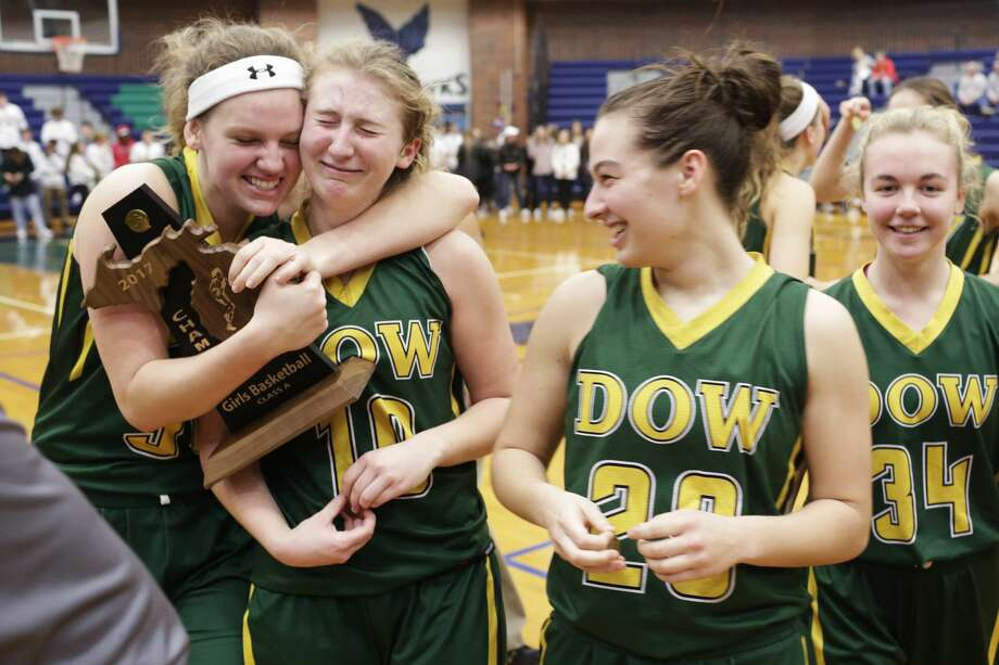 Dow's Kaylee Wasco, Ellie Taylor, and Maizie Taylor celebrate after defeating Bay City Western in the girls basketball Class A district final at Saginaw Heritage High School on Friday. Photo: Theophil Syslo For The Daily News