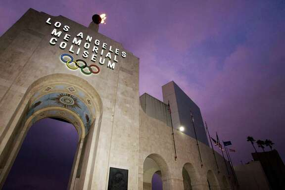 FILE - This Feb. 13, 2008, file photo shows the Los Angeles Memorial Coliseum in Los Angeles. The aging Los Angeles Memorial Coliseum is slated for a major overhaul, but it's not known how much work will be needed to harden the structure against earthquakes in time to make a credible bid for the 2024 Olympics. The 1994 Northridge earthquake heavily damaged the stadium, even though it was 20 miles from the epicenter and the strongest shaking traveled away from the Coliseum (AP Photo/Damian Dovarganes, File)