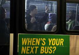OAKLAND, CA - OCTOBER 21:  Commuters pack into an AC Transit bus on October 21, 2013 in Oakland, California.  BART workers continue to strike after contract negotiations between BART management and the transit agency's two largest unions fell apart last week. Management and unions agreed on the financial specifics of the contract but differed on workplace safety rules. An estimated 400,000 commuters ride BART each day.  (Photo by Justin Sullivan/Getty Images)