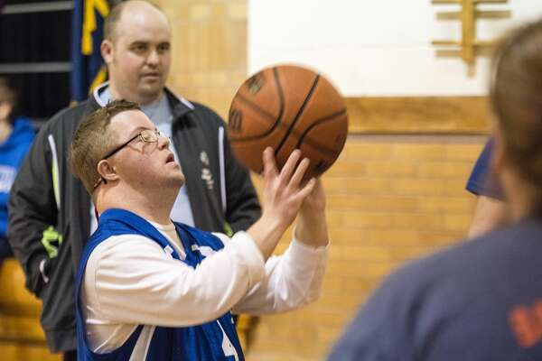 Bay City Area 9 Special Olympics athlete Duane McCann takes a shot during the Special Olympics Skills Tournament on Friday at Eastlawn Elementary School in Midland. McCann placed first in his division of the 10-meter dribble event.