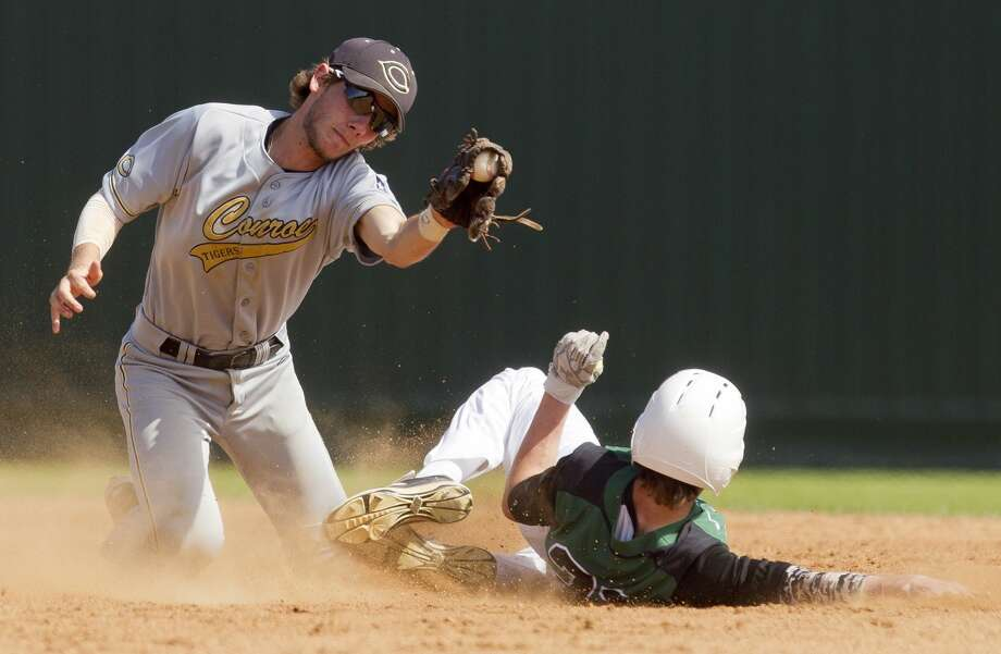 Conroe second baseman Dawson Shibley (5) tries to tag out Deveney of Huntsville stealing second during the second inning of a high school baseball game at the Ferrell Classic Friday, March 3, 2017, in Conroe. Conroe defeated Huntsville 8-3. Photo: Jason Fochtman/Houston Chronicle