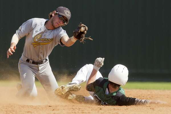 Conroe second baseman Dawson Shibley (5) tries to tag out Deveney of Huntsville stealing second during the second inning of a high school baseball game at the Ferrell Classic Friday, March 3, 2017, in Conroe. Conroe defeated Huntsville 8-4.