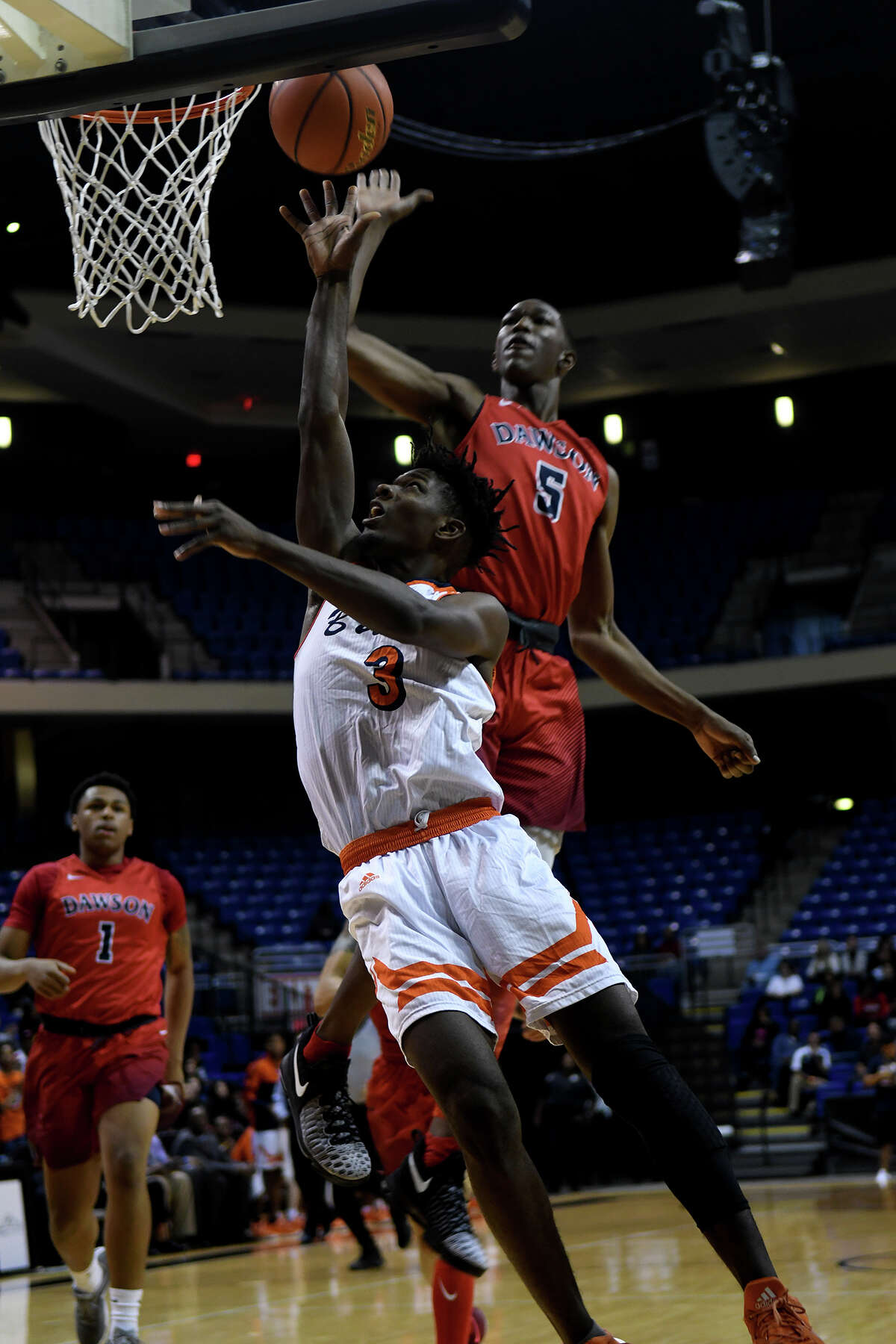 Fort Bend Bush senior forward Trevion Bradley shoots against Pearland Dawson senior forward Karl Nicholas (5) during the 1st quarter of their Class 6A Region III Boys Basketball semifinal at the Richard E. Berry Center in Cypress on Friday, March 3, 2017. (Photo by Jerry Baker/Freelance)