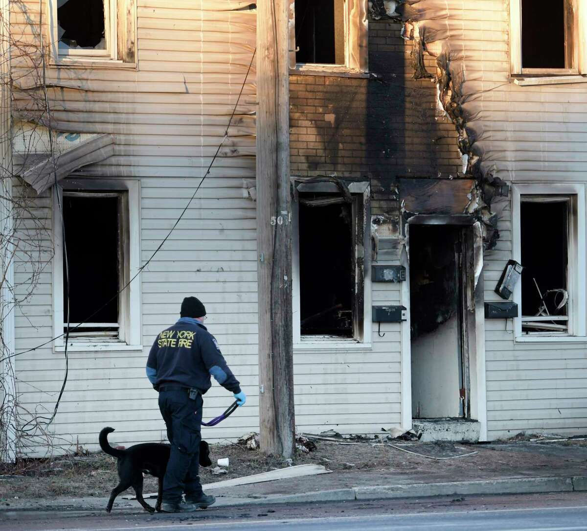 A New York State Fire investigator looks for clues as to the cause of a fire at 1366 Central Avenue Friday Mar. 4, 2017 in Colonie, N.Y. (Skip Dickstein/Times Union)