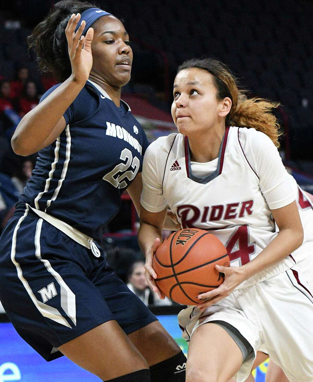 Rider's #44 Safie Tolusso,right, drives past Monmouth's #22 Alexa Middleton during their MAAC tourney game at the Times Union Center Friday March 3, 2017 in Albany, NY. (John Carl D'Annibale / Times Union)