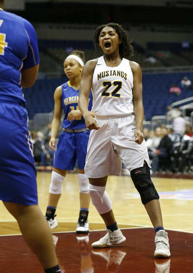 Houston Cypress Ranch's Jala Buster (22) reacts after getting fouled on a score against Pflugerville in the UIL Girls Class 6A State Semifinal basketball game at the Alamodome in San Antonio on Friday, Mar. 3, 2017. Houston Cypress Ranch defeated Pflugerville, 70-53. (Kin Man Hui/San Antonio Express-News) Photo: Kin Man Hui/San Antonio Express-News