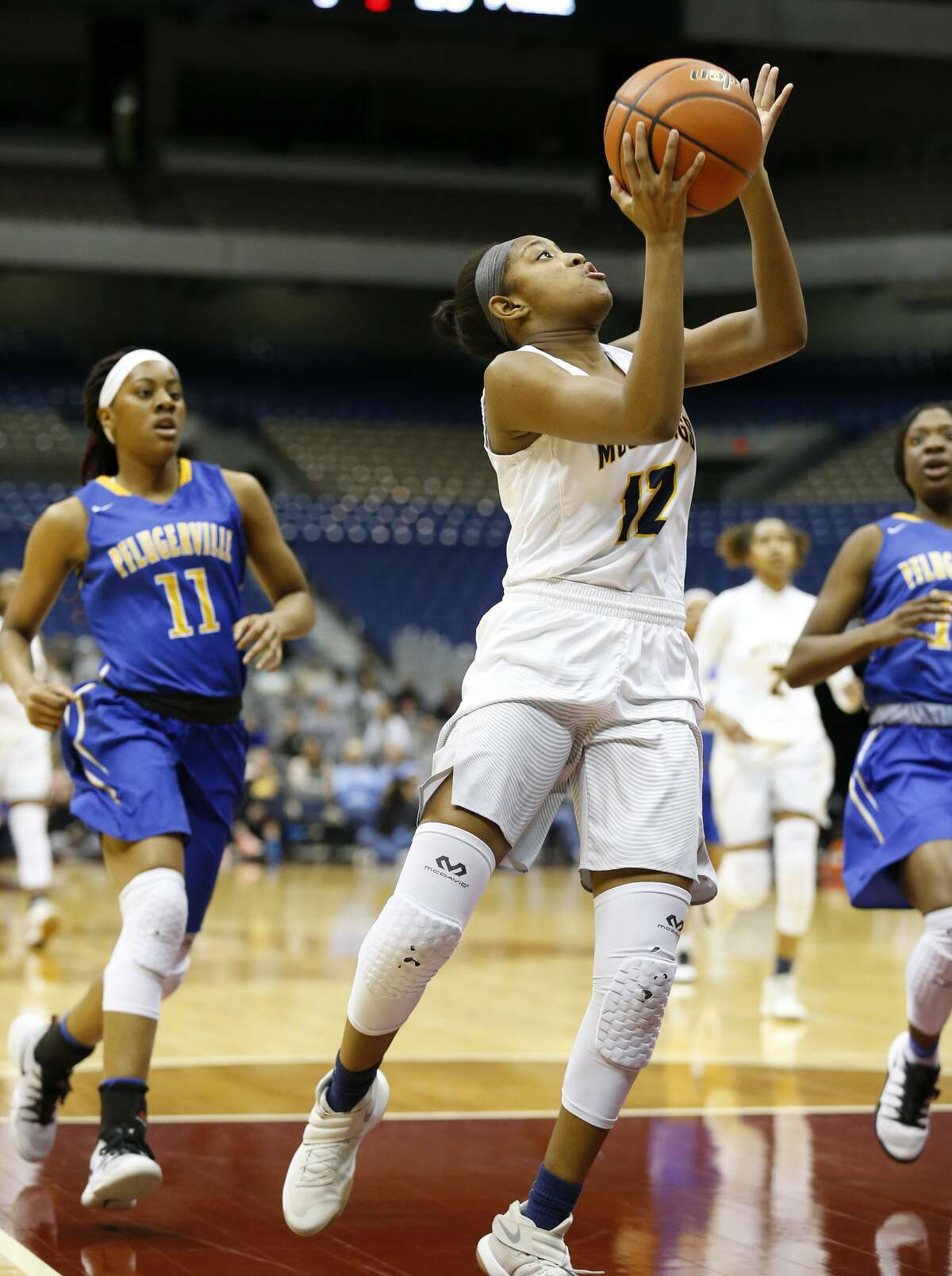 Houston Cypress Ranch?'s Shadiya Thomas (12) goes up for a shot against Pflugerville?'s Britney Onyeje (11) in the UIL Girls Class 6A State Semifinal basketball game at the Alamodome in San Antonio on Friday, Mar. 3, 2017. Houston Cypress Ranch defeated Pflugerville, 70-53, to advance to the state finals on Saturday. (Kin Man Hui/San Antonio Express-News)