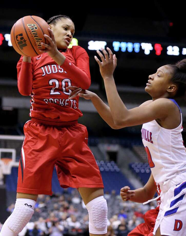 Judson's Tiffany McGarity grabs a rebound around Duncanville's Aniya Thomas during first half action of their Class 6A state semifinal game held Friday March 3, 2017 at the Alamodome. Photo: Edward A. Ornelas, Staff / San Antonio Express-News / © 2017 San Antonio Express-News