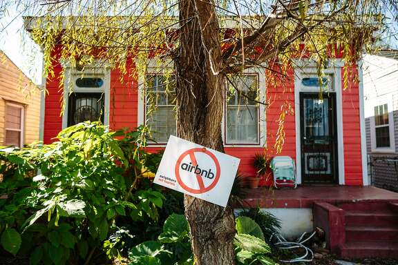 FILE -- An anti-AirbnB sign in the front yard of a home in New Orleans, Feb. 7, 2016. Airbnb has had a contentious relationship in some cities where it has set up shop, but  it has taken a different, more conciliatory approach in New Orleans, but not everyone has been won over. (William Widmer/The New York Times)
