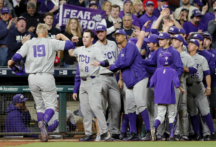 TCU infielder Luken Baker (19) is congratulated by teammates after a second inning home run during the NCAA baseball game between the LSU Tigers and the TCU Horned Frogs at Minute Maid Park in Houston, TX on Friday, March 3, 2017. Photo: Tim Warner/For The Chronicle