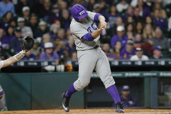 TCU infielder Luken Baker (19) singles in the ninth during the NCAA baseball game between the LSU Tigers and the TCU Horned Frogs at Minute Maid Park in Houston, TX on Friday, March 3, 2017.