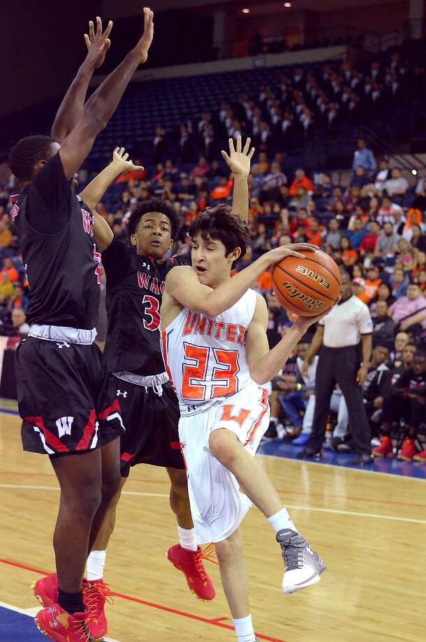 Jalen Jackson and Jalen Hanspard defend for Wagner as United's Andrey Pompa looks to the pass the ball under the basket in the UIL Boys Basketball Region IV-6A tournament at the Laredo Energy Arena, Friday, March 3, 2017. Photo: Cuate Santos / Laredo Morning Times / Laredo Morning Times