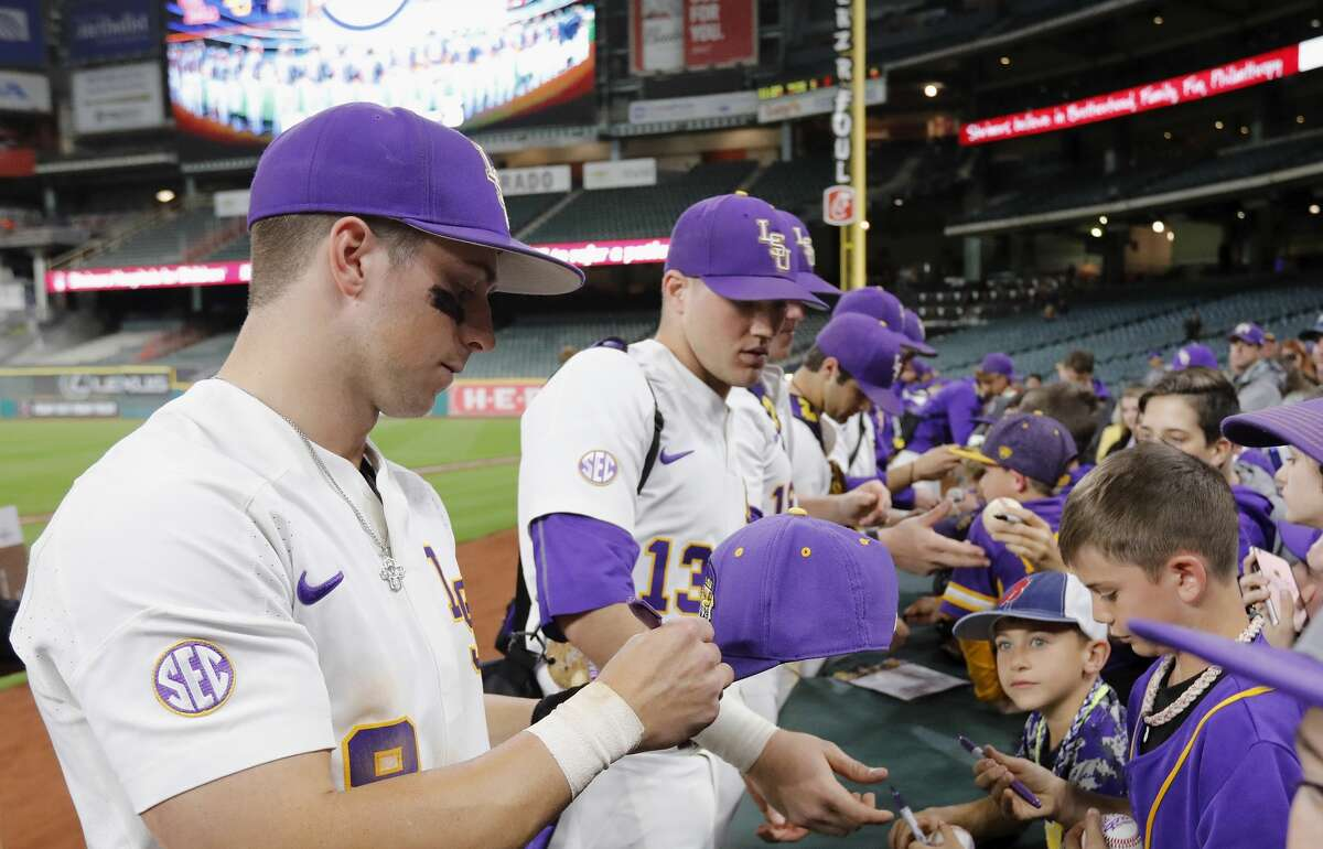 LSU infielder Cole Freeman (8) and LSU catcher Nick Coomes (13) sign autographs after the NCAA baseball game between the LSU Tigers and the TCU Horned Frogs at Minute Maid Park in Houston, TX on Friday, March 3, 2017.