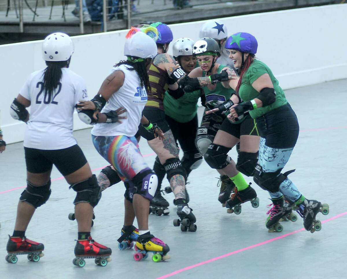 Members of the local roller derby leagues participate in a demonstration at the opening of the skating rink at Discovery Green Park Friday March 03,2017. (Dave Rossman Photo)
