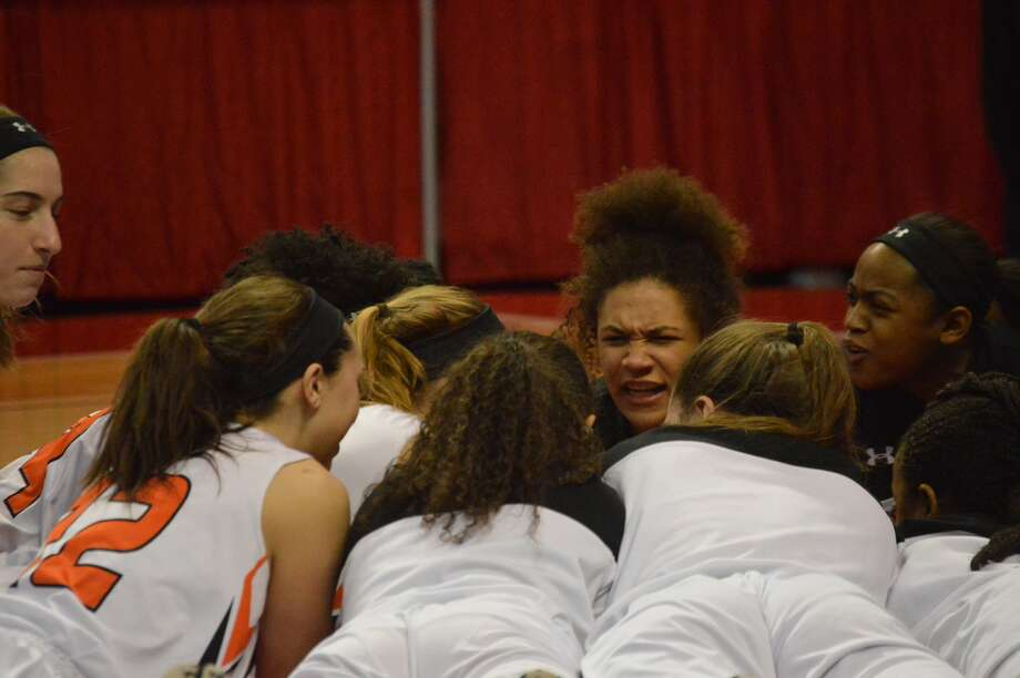 Edwardsville freshman Maria Smith fires up the team before Friday's game.