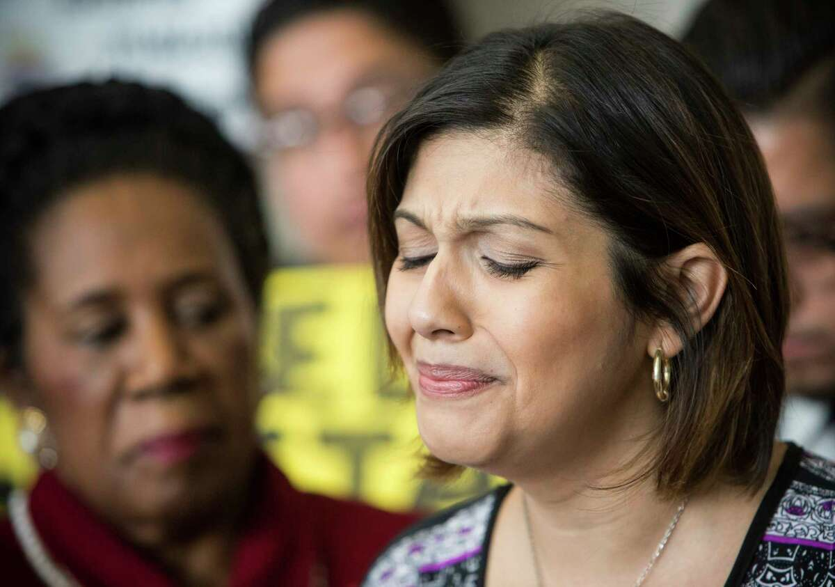 Rose Escobar, left, pauses as she speaks during a news conference in opposition against mass deportation, and to also speak out against the deportation of her husband Jose Escobar on Friday, March 3, 2017, in Houston. Escobar was deported back to El Salvador on Thursday, a country has hasn't been to in more than 15 years.