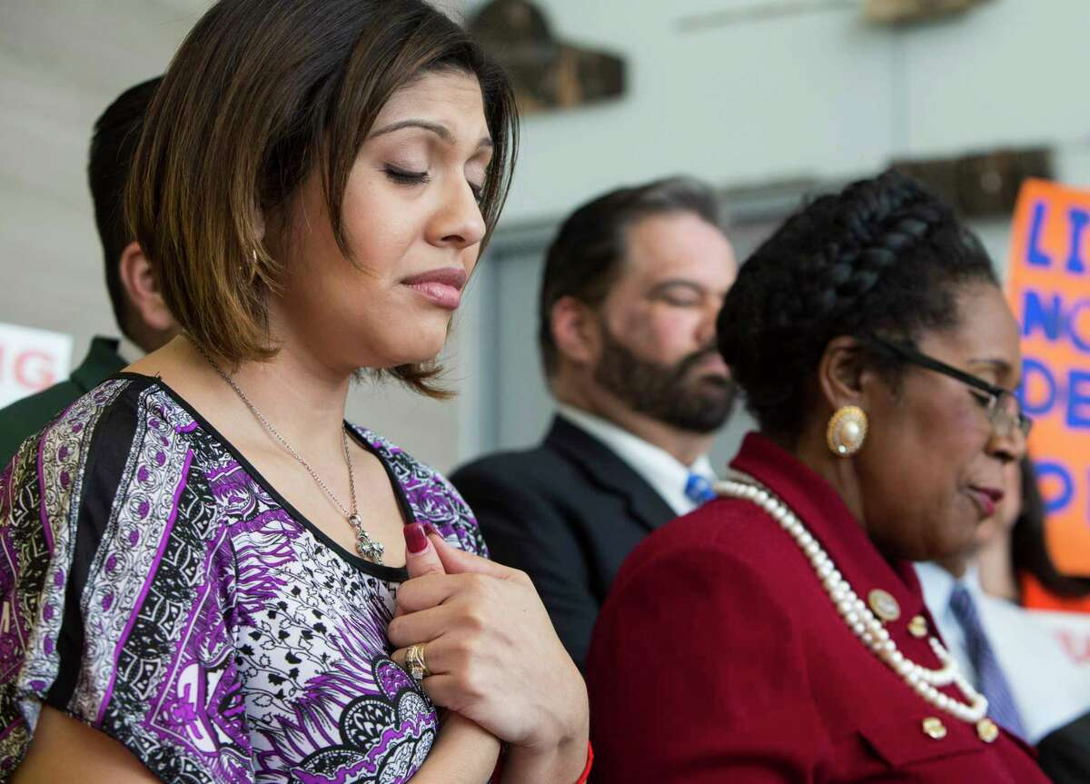 Rose Escobar, left, stands with Rep. Sheila Jackson Lee, D-Texas, during a news conference in opposition against mass deportation, and to also speak out against the deportation of Jose Escobar on Friday, March 3, 2017, in Houston. Escobar was deported back to El Salvador on Thursday, a country has hasn't been to in more than 15 years.
