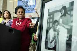 Rep. Sheila Jackson Lee, D-Texas, points to a photo of Jose and Rose Escobar during a news conference in opposition against mass deportation, and to also speak out against the deportation of Jose Escobar on Friday, March 3, 2017, in Houston. Escobar was deported back to El Salvador on Thursday, a country has hasn't been to in more than 15 years.
