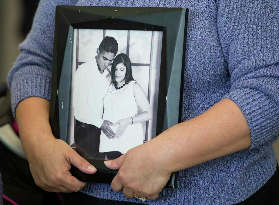 A supporter of Jose and Rose Escobar holds a photo of the couple during a news conference in opposition against mass deportation, and to also speak out against the deportation of Jose Escobar on Friday, March 3, 2017, in Houston. Escobar was deported back to El Salvador on Thursday, a country has hasn't been to in more than 15 years. Photo: Brett Coomer, Houston Chronicle / © 2017 Houston Chronicle