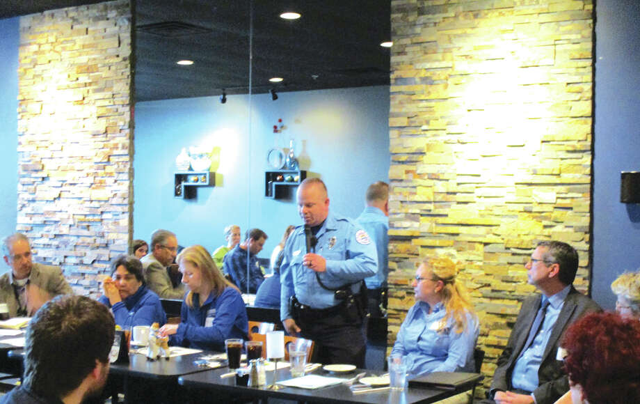 Edwardsville Police Officer Andy Feller speaks at the township's Lunch and Learn event. Photo: For The Intelligencer