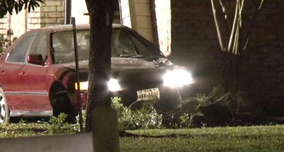A driver lost control early Saturday morning, slamming into a house in Jersey Village, authorities said.  The driver lost control for unknown reasons around 2 a.m., slamming into the front of the house on Delozier at Rio Grande Street, and knocked out the front living room wall. Photo: Metro Video