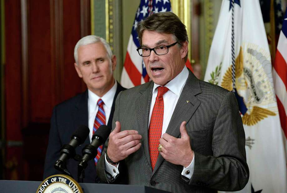 Accompanied by Vice President Mike Pence, Rick Perry speaks after being sworn in as secretary of energy. On Friday, he addressed the department's employees.Keep going for a look back at Rick Perry's tenure in Texas through the eyes of Houston Chronicle editorial cartoonist Nick Anderson. Photo: Olivier Douliery, MBR / Abaca Press