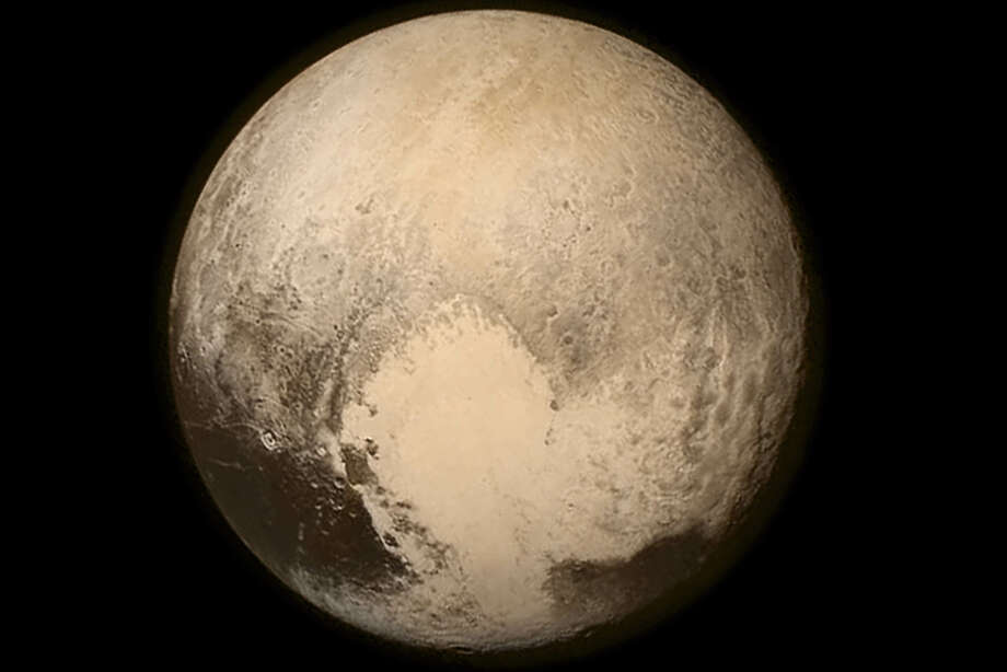 A NASA image from July 13, 2015 shows Pluto from NASA's New Horizons spacecraft just before making its closest approach to Pluto on July 14. The spacecraft has traveled 3 billion miles since launch on January 19, 2006. NASA/APL/SwRI/UPI / UPI