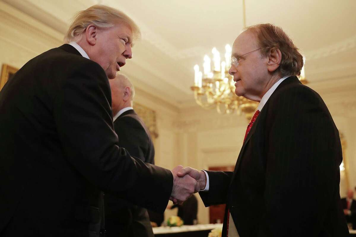 WASHINGTON, DC - FEBRUARY 03: U.S. President Donald Trump (R) greets Cambridge Energy Research Associates Chairman Daniel Yergin at the beginning of a policy forum in the State Dining Room at the White House February 3, 2017 in Washington, DC. Leaders from the automotive and manufacturing industries, the financial and retail services and other powerful global businesses were invited to the meeting with Trump, his advisors and family. (Photo by Chip Somodevilla/Getty Images)