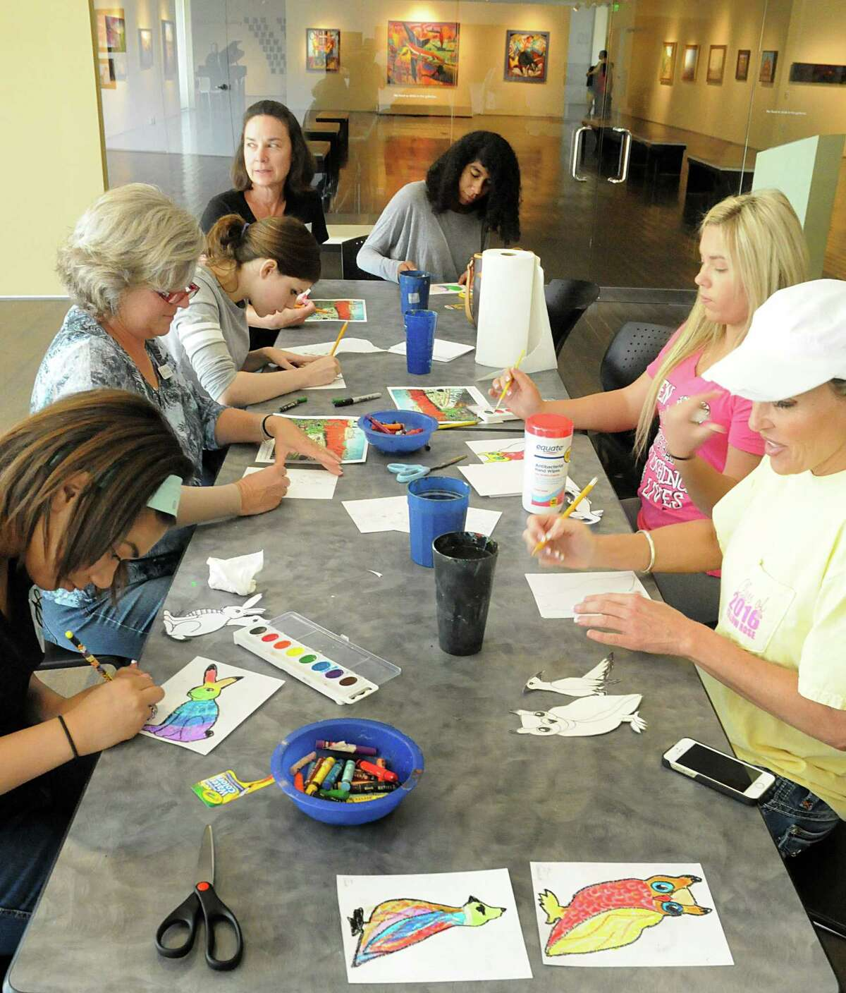Volunteers and guests work on their art projects during the Pearl Fincher Museum of Fine Arts, 6815 Cypresswood Drive in Spring, Family Day. Live art demonstrations, performances, and hands on art projects were part of days events. Photograph by David Hopper