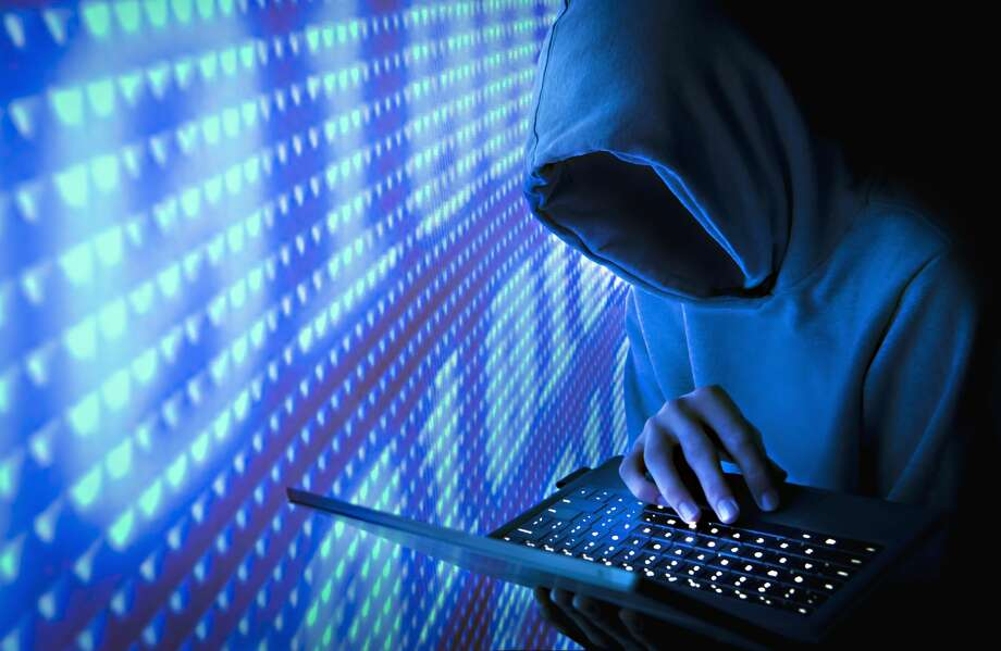 A Seattle-area man accused of hacking news websites that reported on an international credit card scam he perpetrated has been arrested. Photo: Bill Hinton/Getty Images