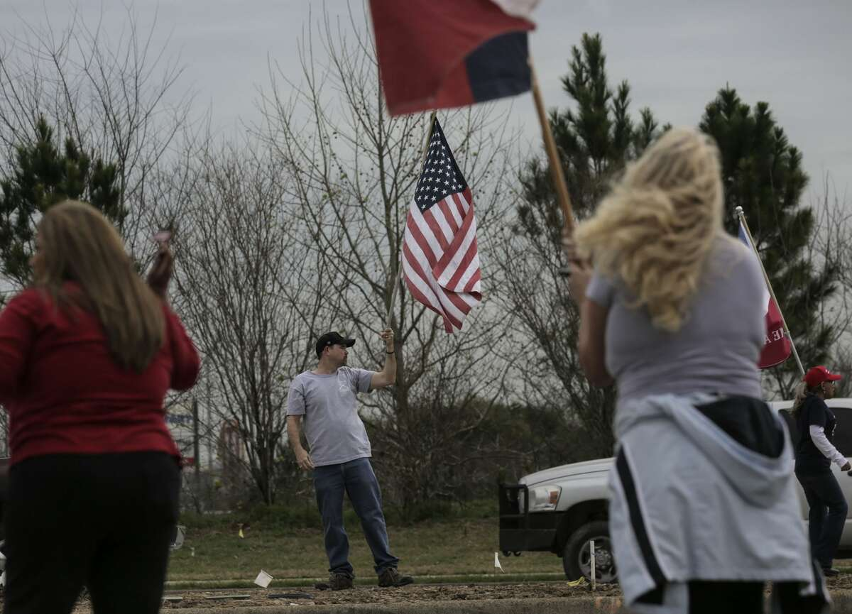 President Trump supporters line Fry Road during a rally in support of the president on Saturday, March 4, 2017, in Katy. ( Elizabeth Conley / Houston Chronicle )