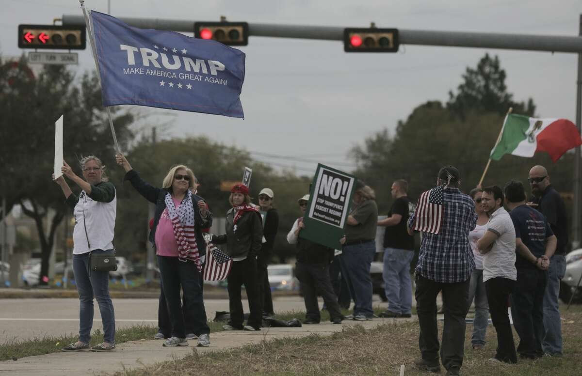 President Trump supporters line Fry Road next to counter protesters during a rally in support of the president on Saturday, March 4, 2017, in Katy. ( Elizabeth Conley / Houston Chronicle )