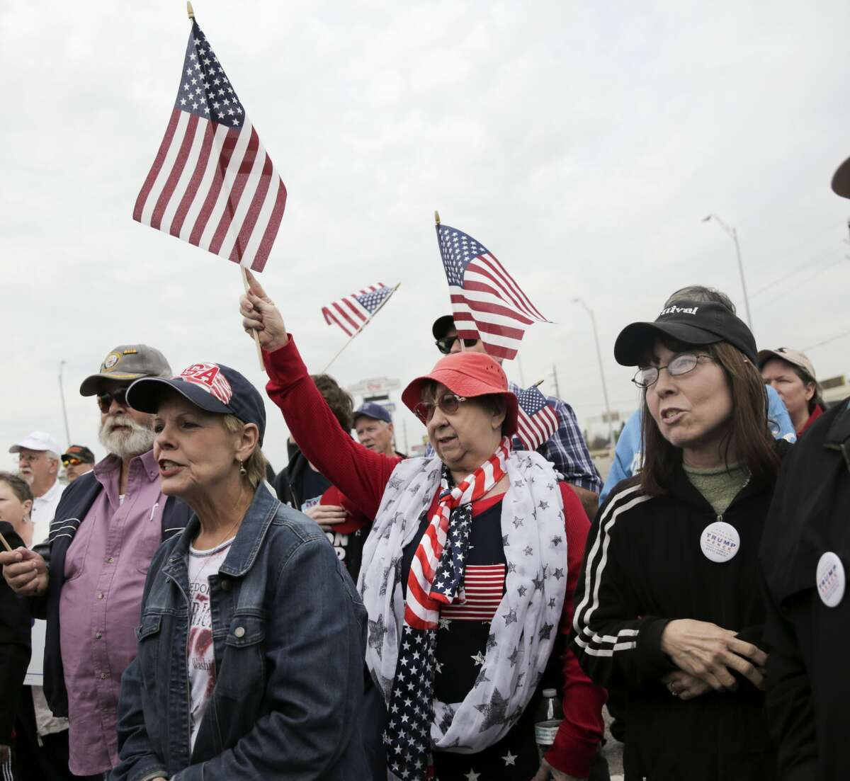 Jo Anne Henry of Yorktown, Texas listens during a rally in support of the President Trump on Saturday, March 4, 2017, in Katy. ( Elizabeth Conley / Houston Chronicle )