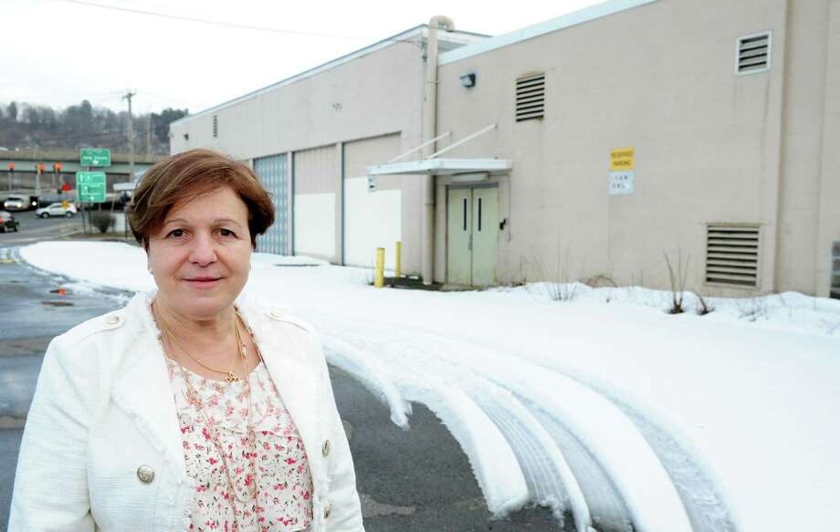 Derby Mayor Anita Dugatto stands in front of the former Lifetouch building at 90 Main Street in Derby, Conn. on Wednesday Feb. 22, 2017. A Shelton developer proposed to the Derby P&Z committee in making the former Lifetouch building the gateway to a redeveloped Main Street. He suggested putting a hotel, or a community college and manufacturing plant on the site which is across from Home Depot. Photo: Christian Abraham / Hearst Connecticut Media / Connecticut Post