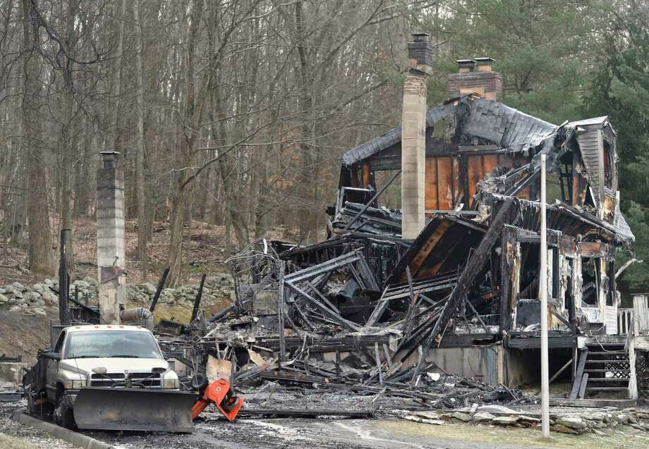 Police and fire departments from several town agencies responded to an explosion that caused a house fire at 6 Mare Lane, in New Milford, Conn, the Northville Volunteer Fire Department confirms. Friday night, March 3, 2017. Photo: H John Voorhees III, Hearst Connecticut Media / The News-Times