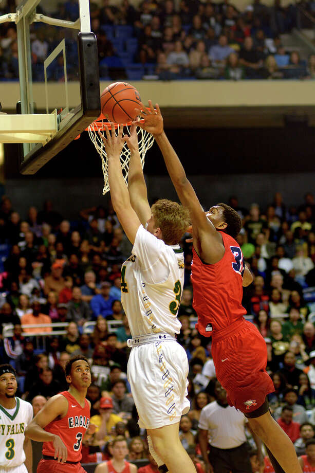Cy Falls senior post Justin Skopal, left, gets his shot blocked by Atascocita senior forward Fabian White during the 2nd quarter of their Class 6A Region III Boys Basketball semifinal at the Richard E. Berry Center in Cypress on Friday, March 3, 2017. (Photo by Jerry Baker/Freelance) Photo: Jerry Baker, Freelance / Freelance