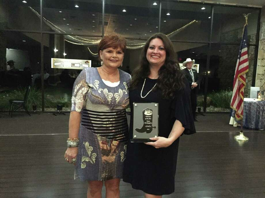 Linda Williams, right, presents the award for Volunteer of the Year to Tatum MacNaughton Photo: Julie Silva