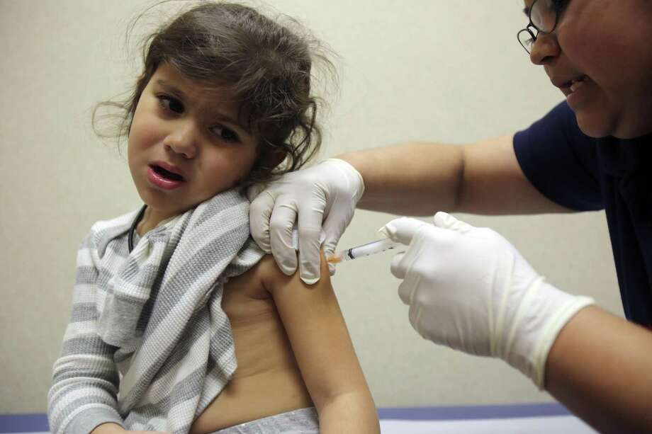 Texas requires students to receive seven vaccines to attend public school. These include a single vaccine for measles, mumps and rubella. Photo: San Antonio Express-News / File Photo / ©2013 San Antonio Express-News