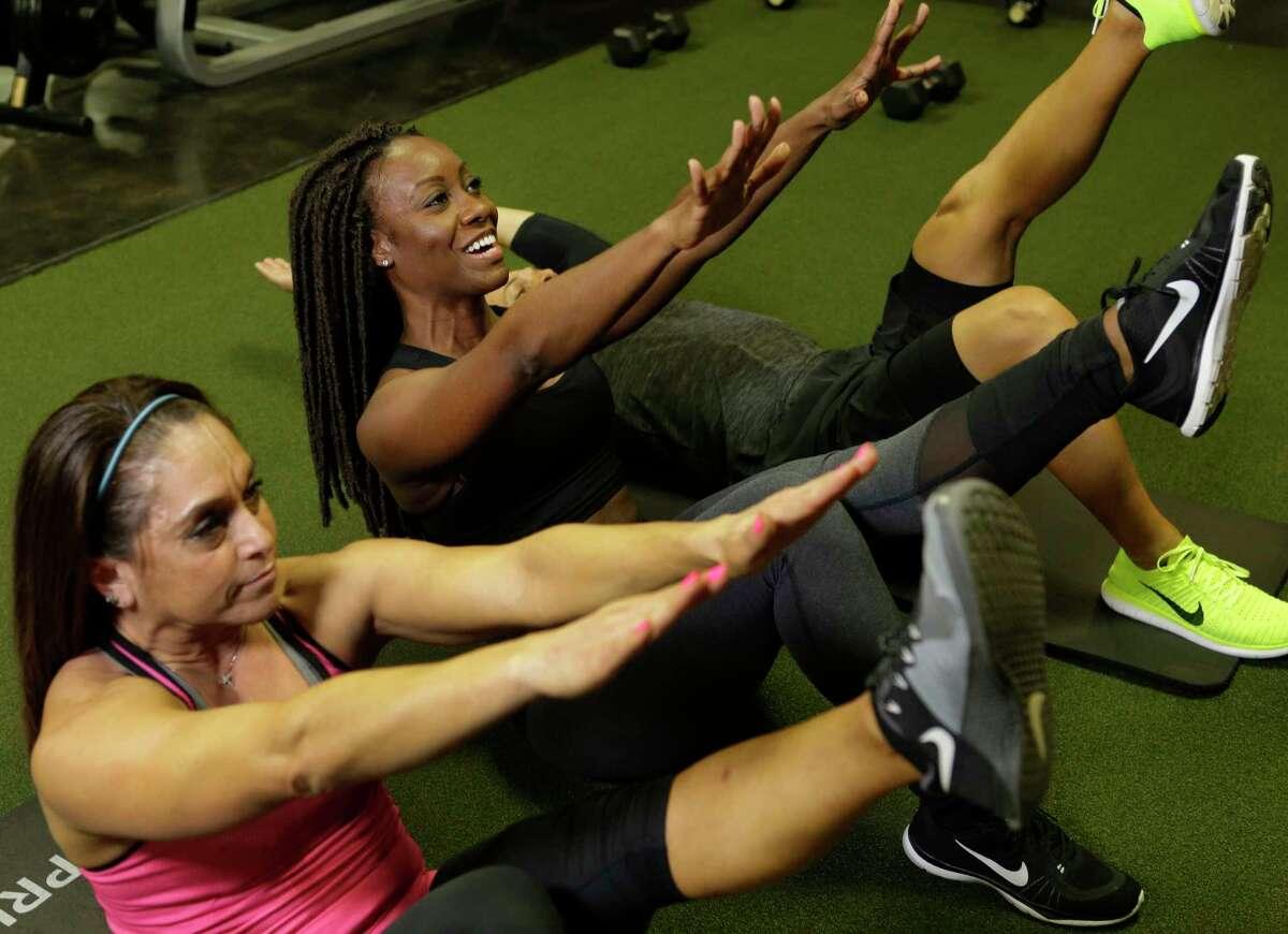 Trainer Meoka McBride, right, works with Marie Moreno.
