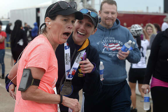 Half marathon winner Amanda Lavergne celebrates with her mother LeRae Lavergne after she comes in from her run and the pair take in her time during the 8th annual Gusher Marathon Saturday in Beaumont.  Photo taken Saturday, March 4, 2017 Kim Brent/The Enterprise