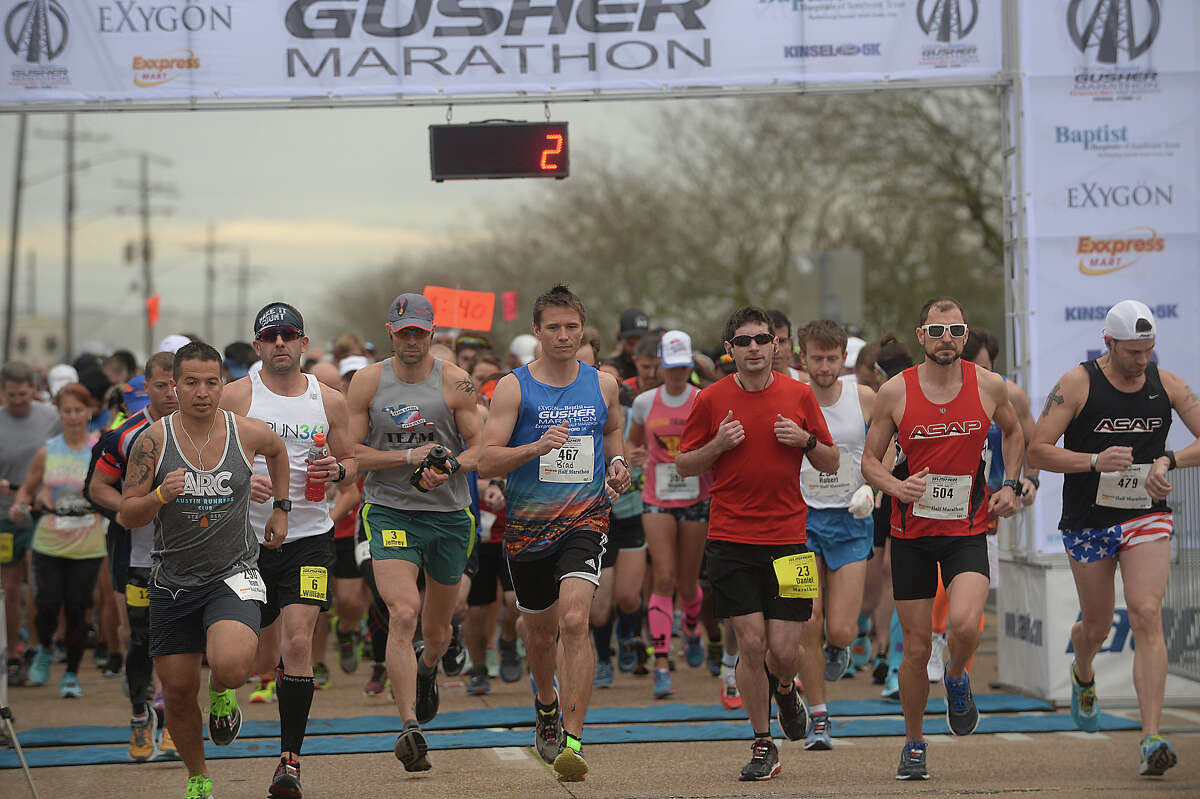 Half and full marathoners take off on the start of their race during the 8th annual Gusher Marathon Saturday in Beaumont. Photo taken Saturday, March 4, 2017 Kim Brent/The Enterprise